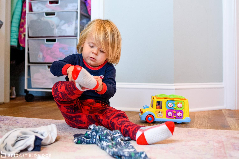 boy puts on his socks in washington dc