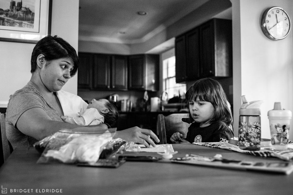 mom and daughter have a debate over what food to eat for lunch