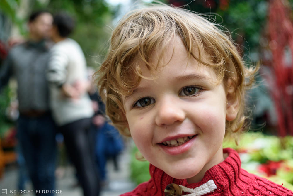 portrait of a boy in the us botanic garden with his parents in the background