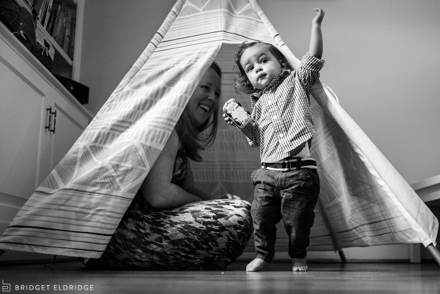 mom and her son play in his tepee