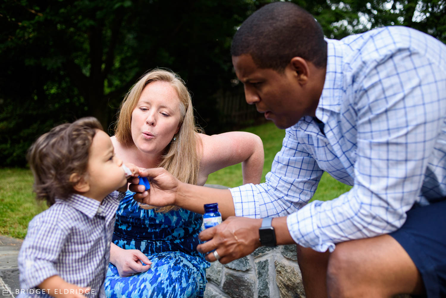 bethesda, md family blows bubbles together in their backyard