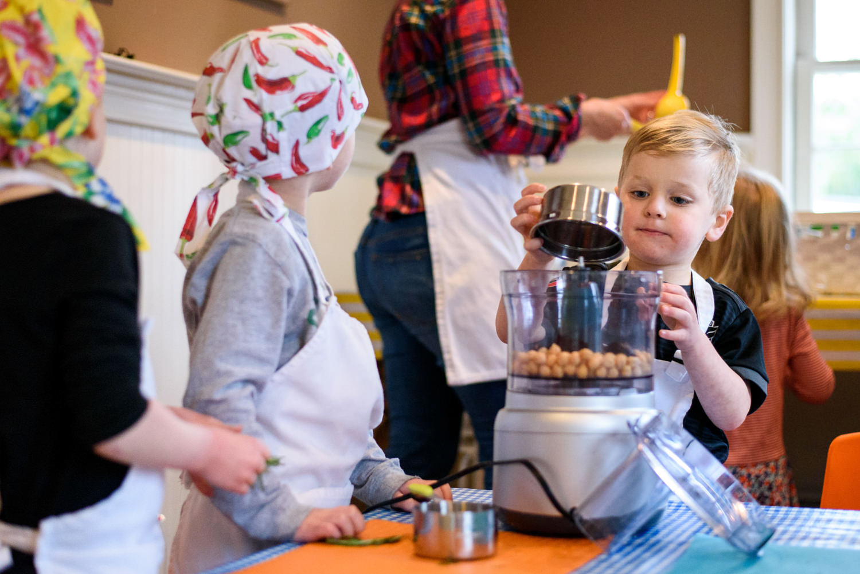 Boy empties chick peas into food processor