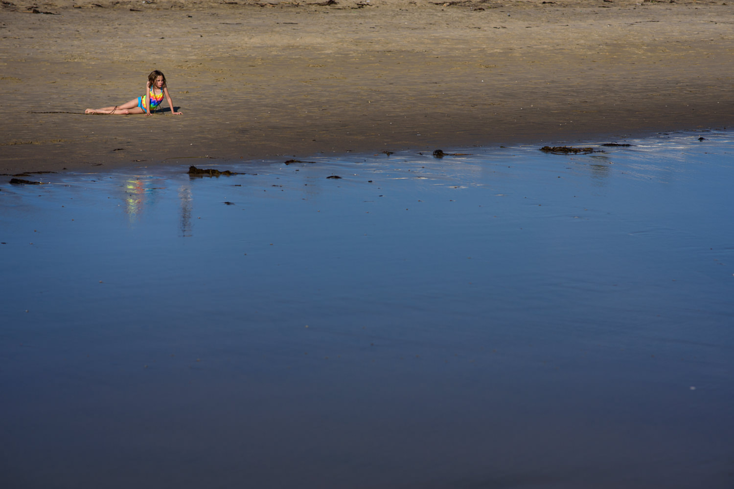 girl hangs out on the beach in orange county