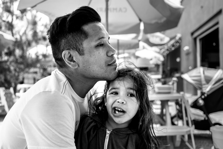 dad gives daughter a hug