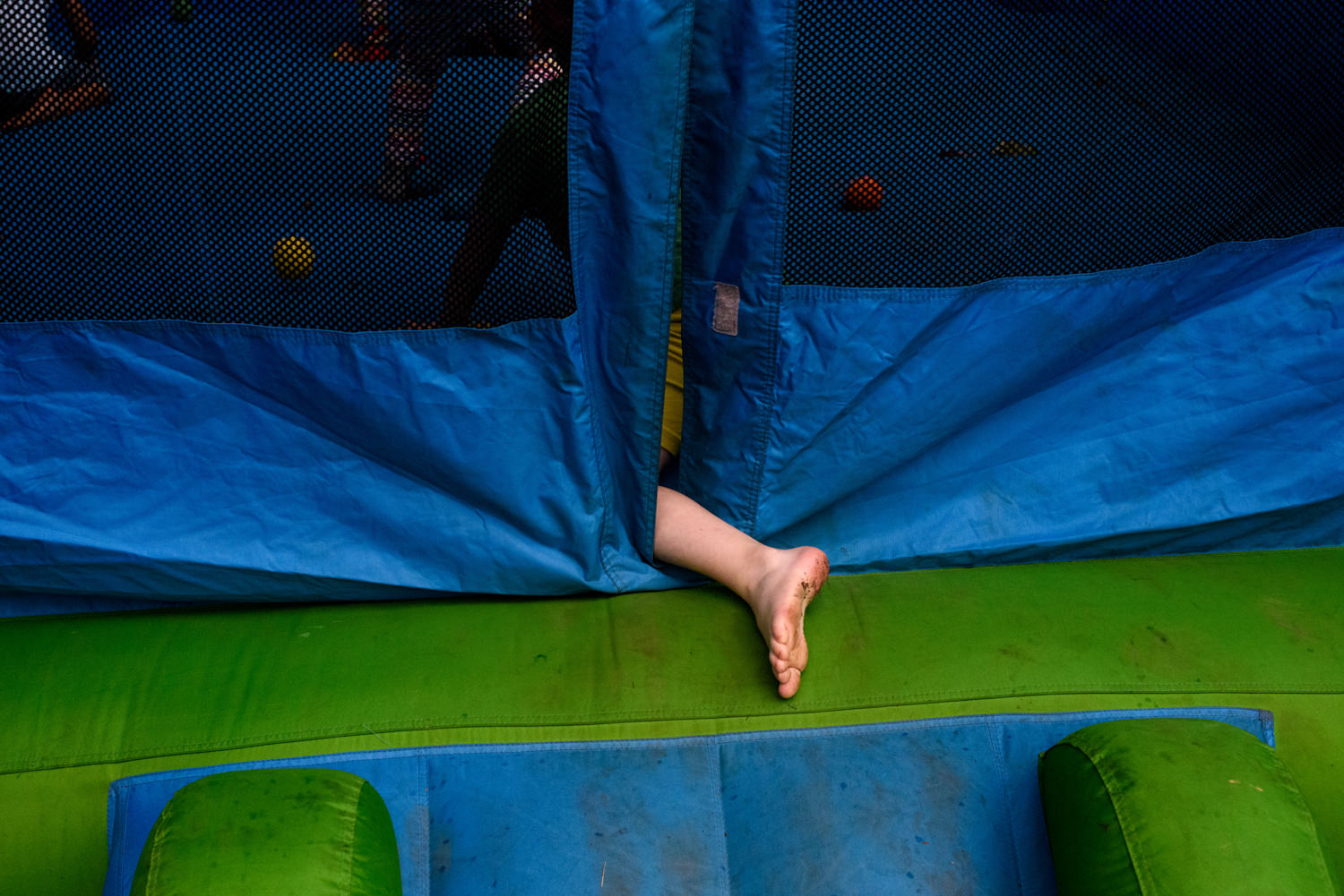 dirty foot as kid gets on the trampoline