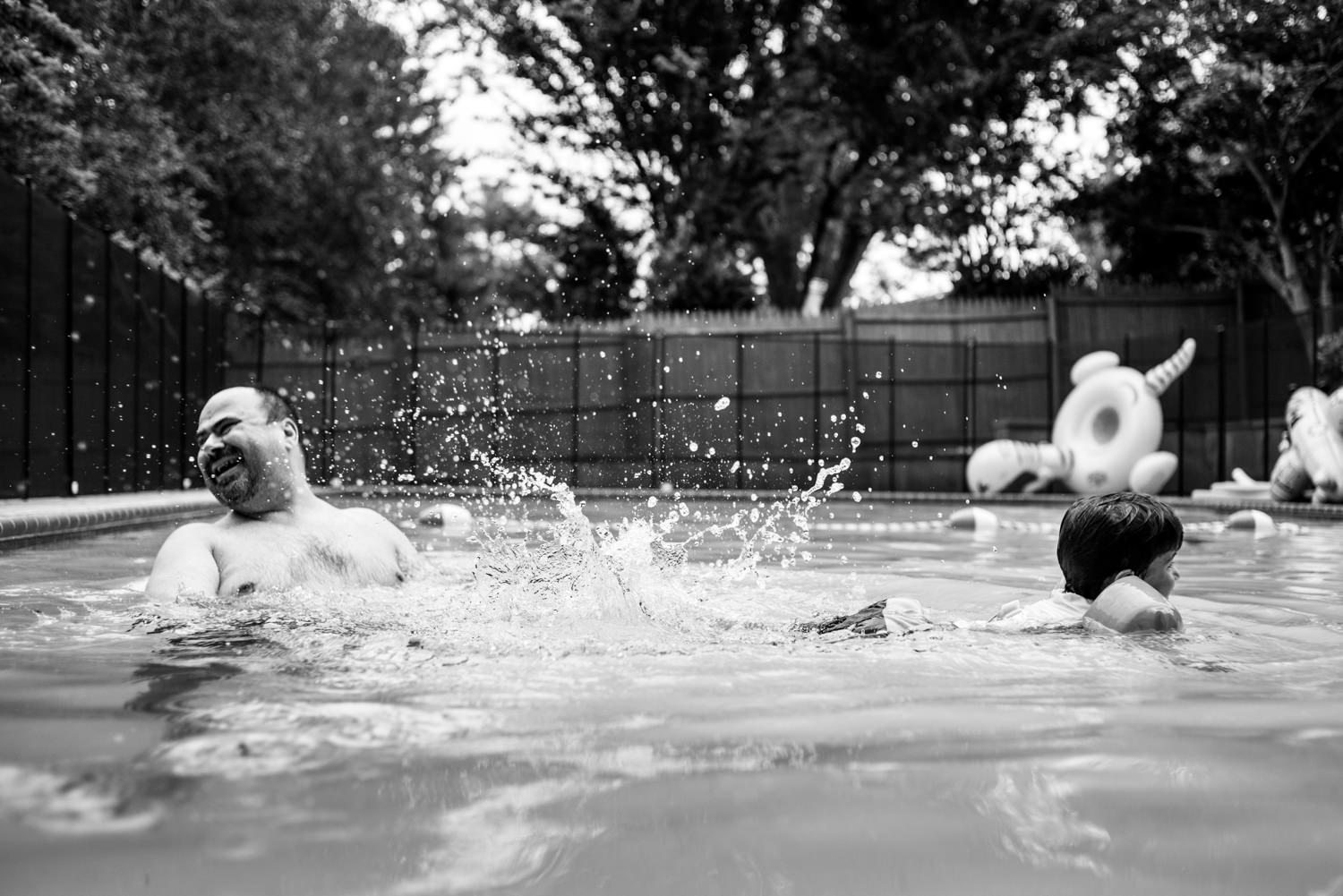 boy splash his father in the pool