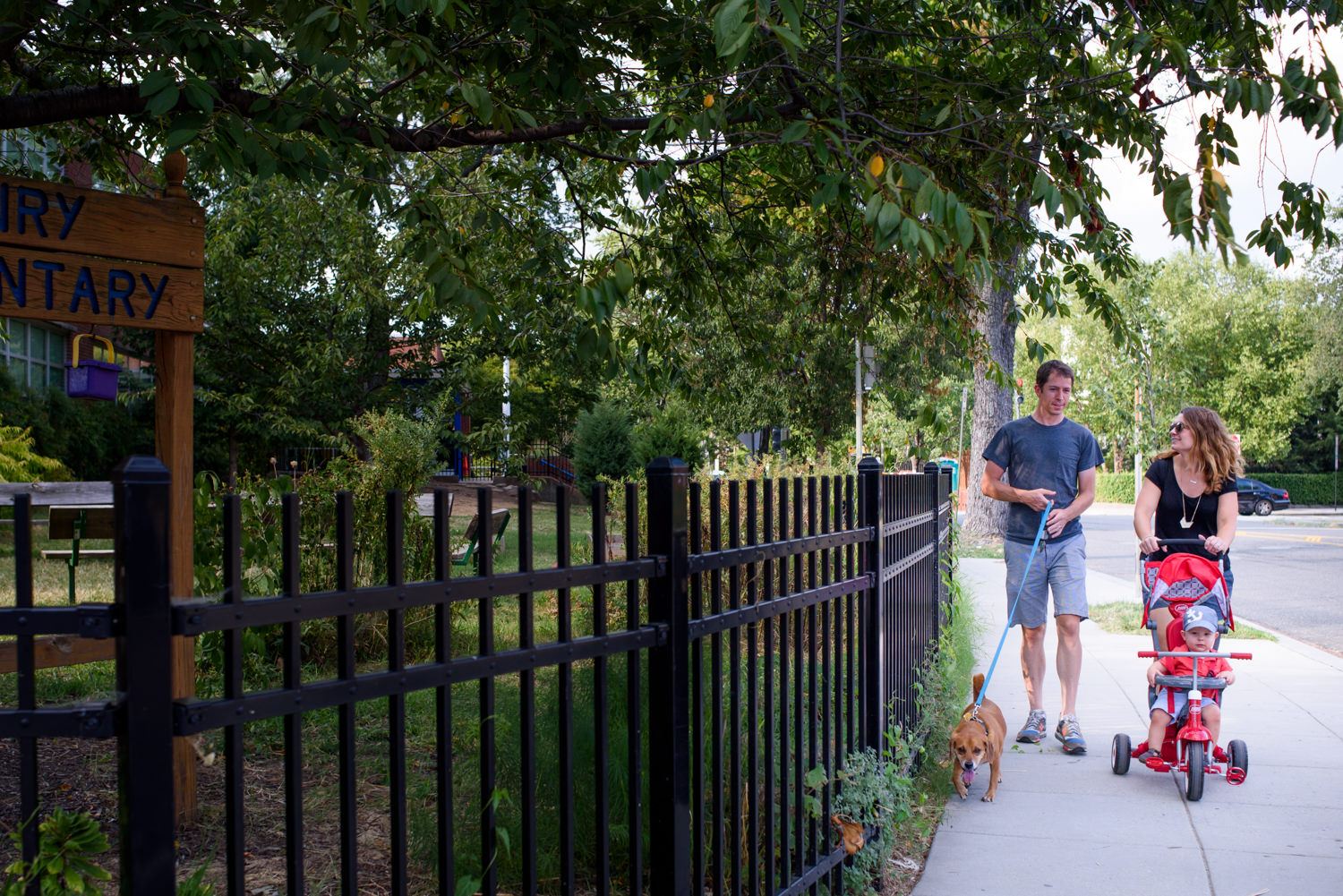 family takes a walk in the capitol hill neighborhood of washington dc