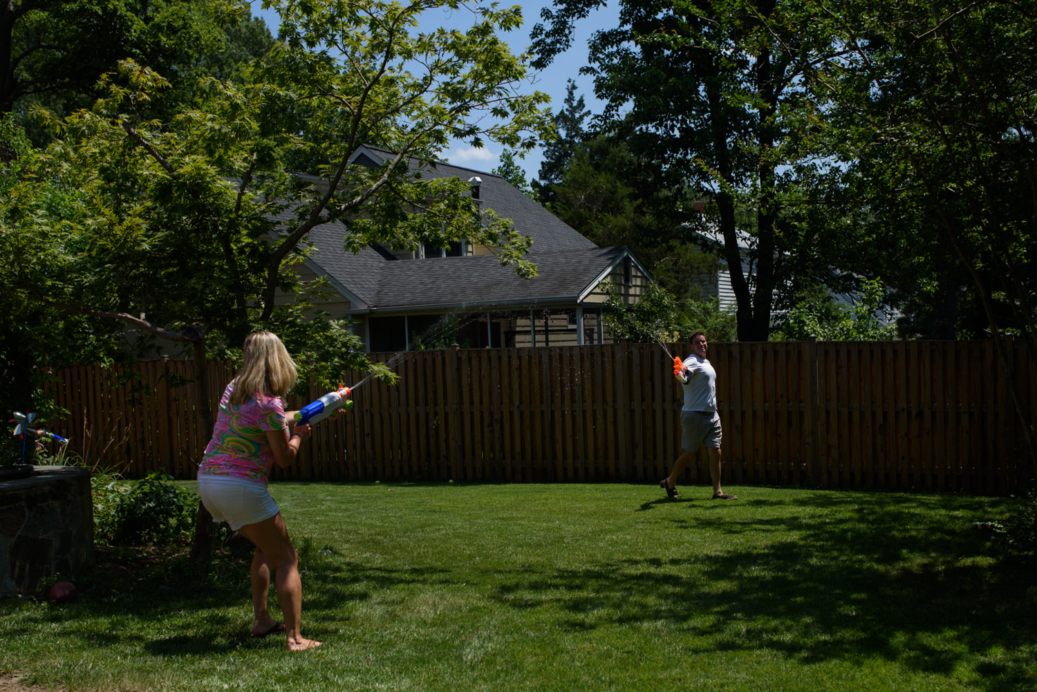 mom and dad have a water gun fight