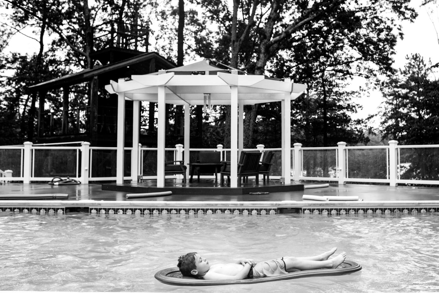 boy relaxes in the pool