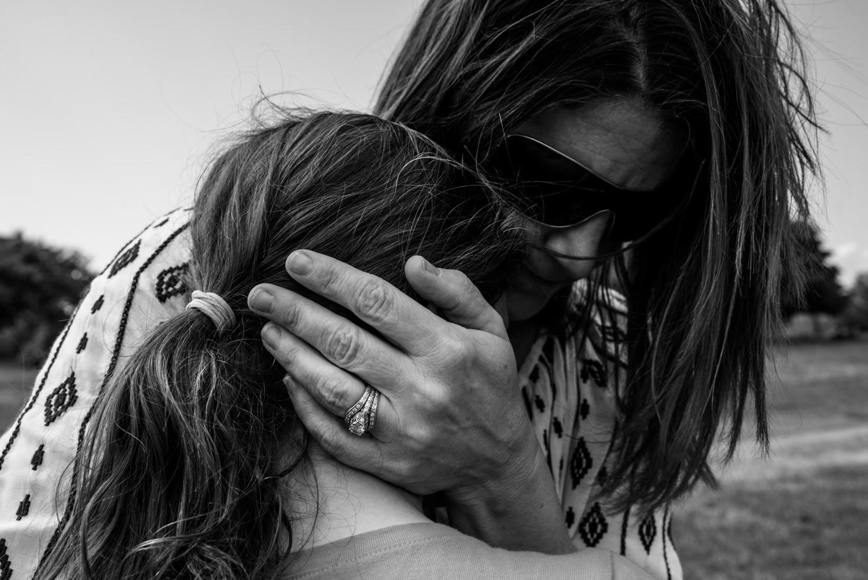 mom hugs her daughter in arlington va