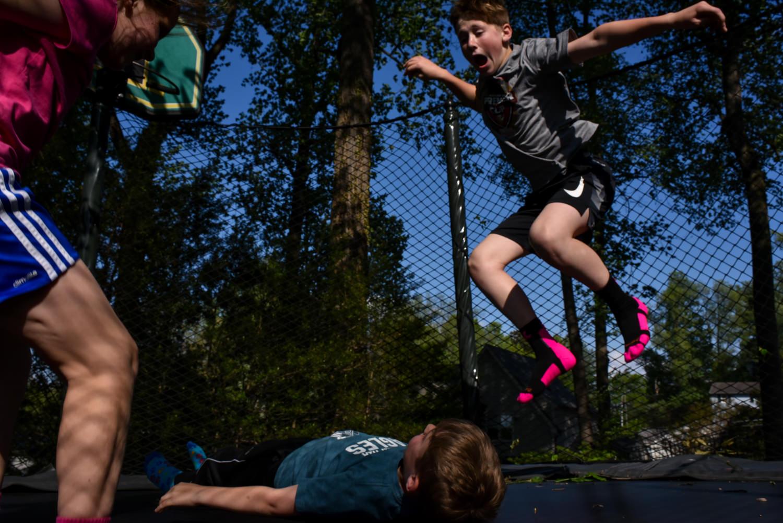 kids jump on a trampoline