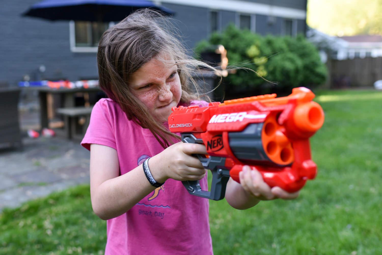 girl fires a water gun
