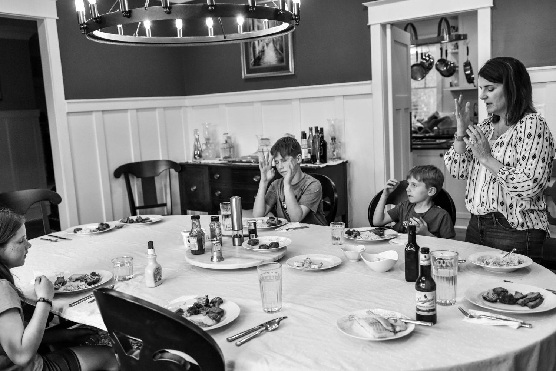 family says prayers before dinner