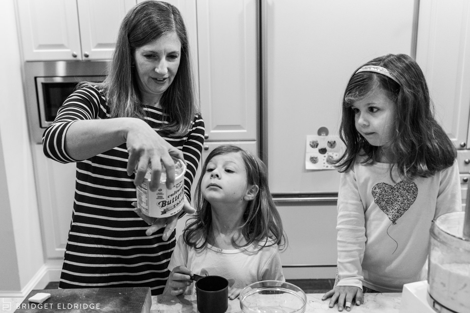 mom and her daughters make scones