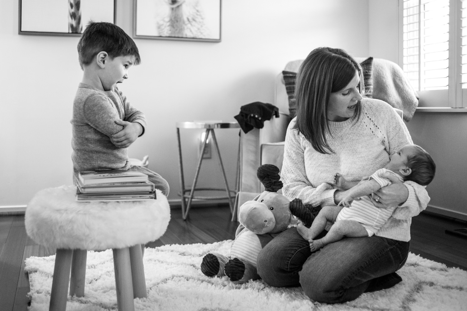 brother plays school with mom and new baby brother