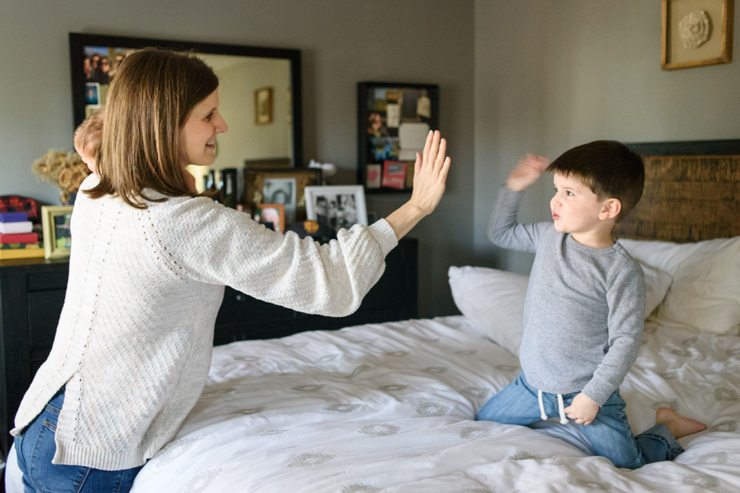 mom gives the big brother a high five