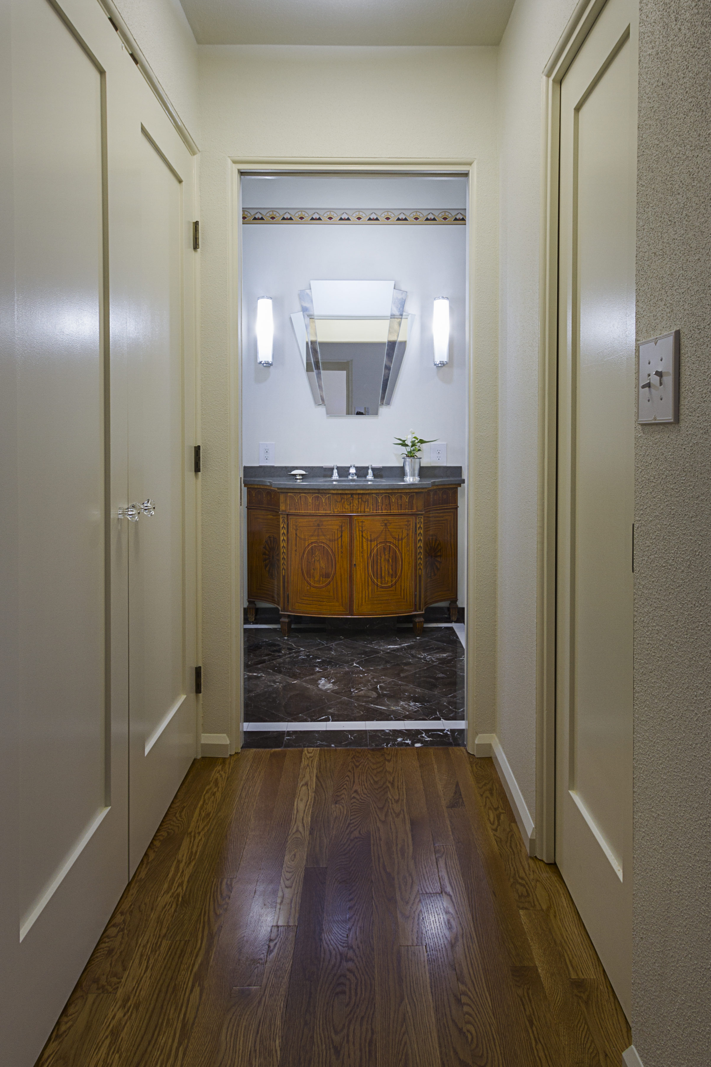 The Master Bathroom is located at the end of this short Hallway, off the  Master Bedroom. To the left is the Laundry Closet, to the right is the  Master Closet.