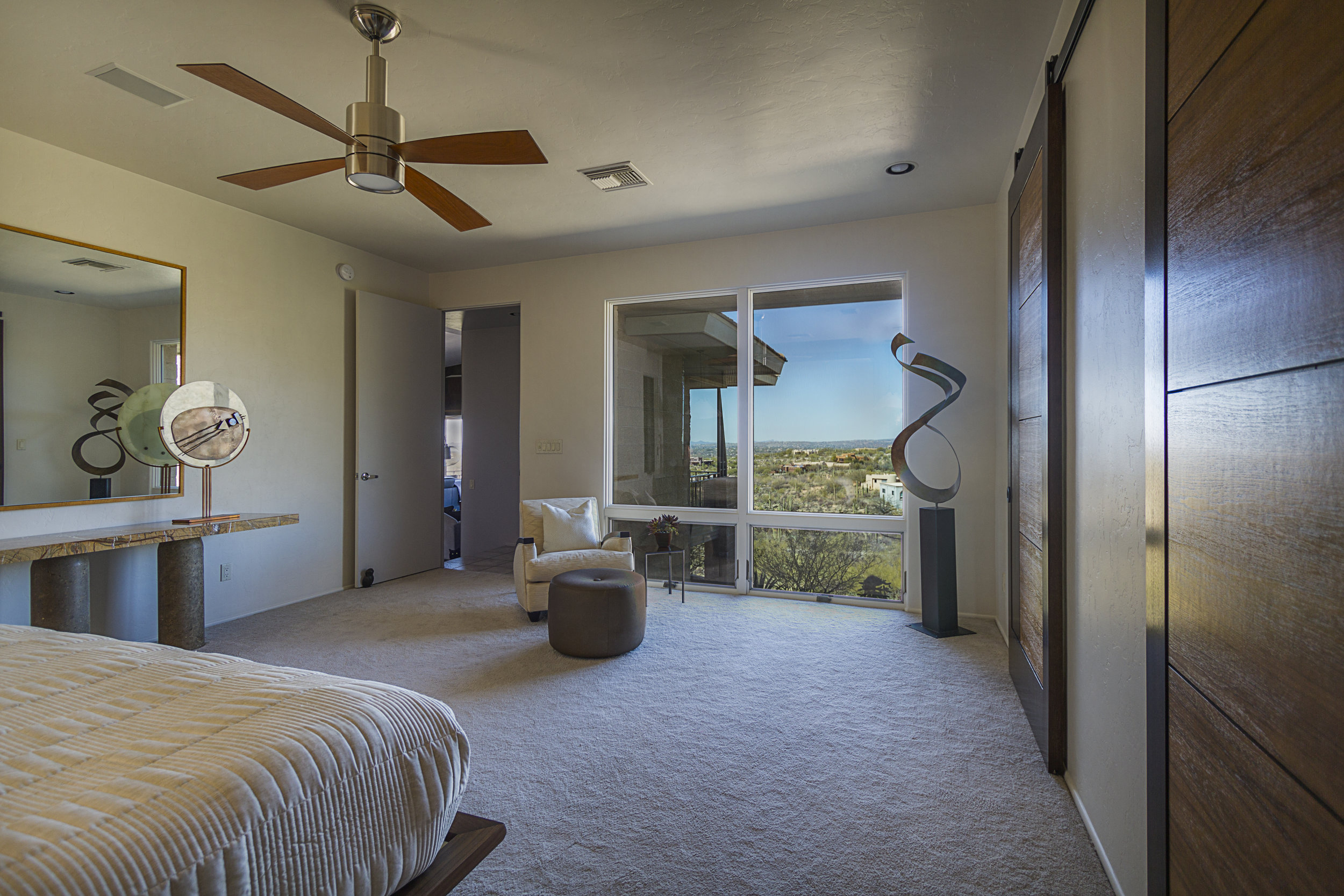 The new windows more than double the amount of glass and view, filling  the Master Bedroom with natural light and views of the desert landscape  and the mountains beyond.