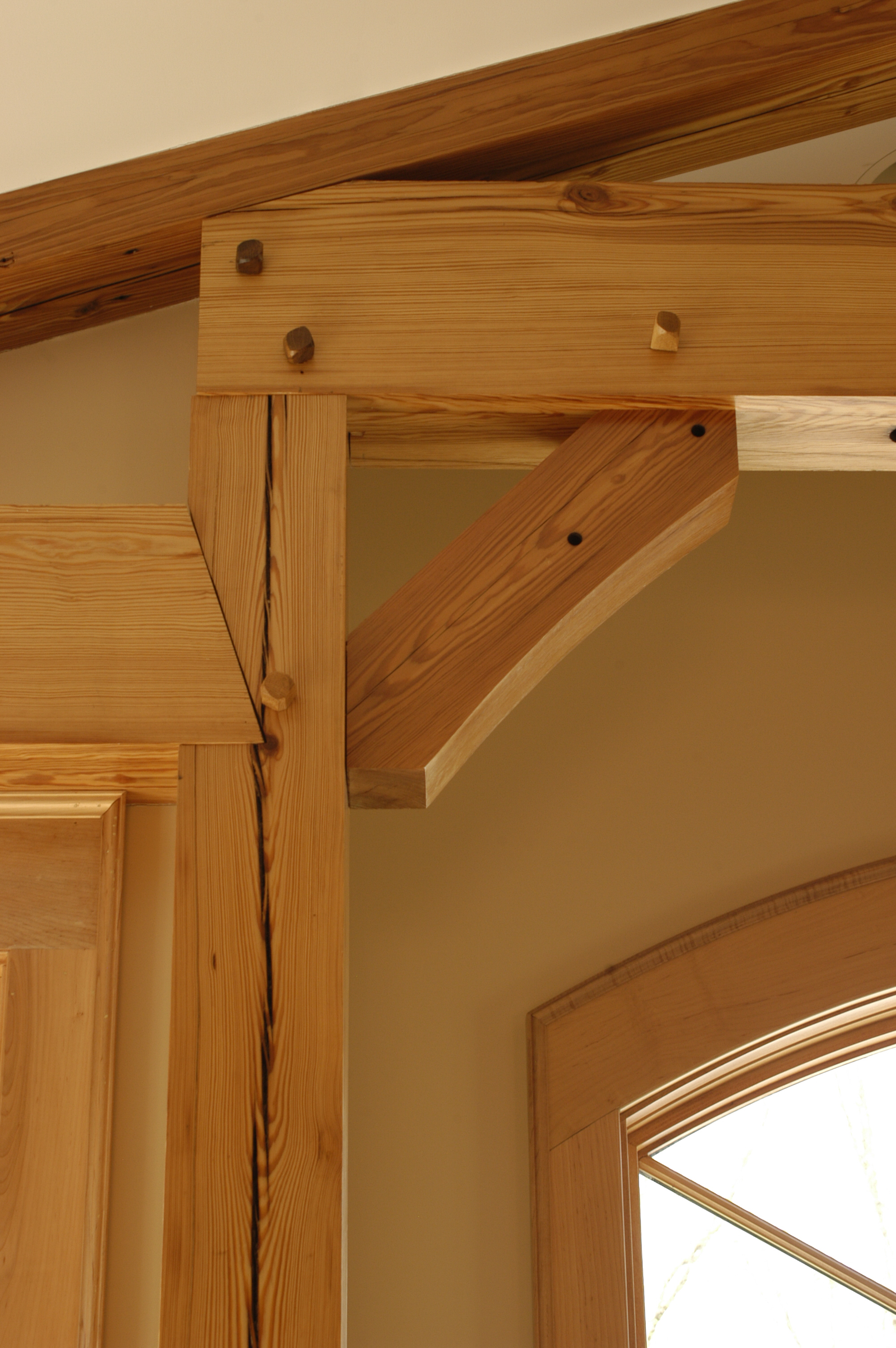 Details of the hand pegged, heavy timber trusses.