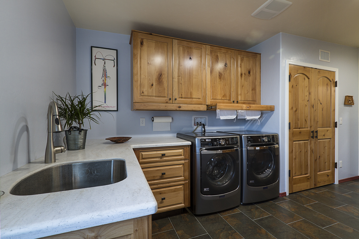 Secret pull-out drying racks over the washer and dryer help with those oddly-shaped garments and towels.