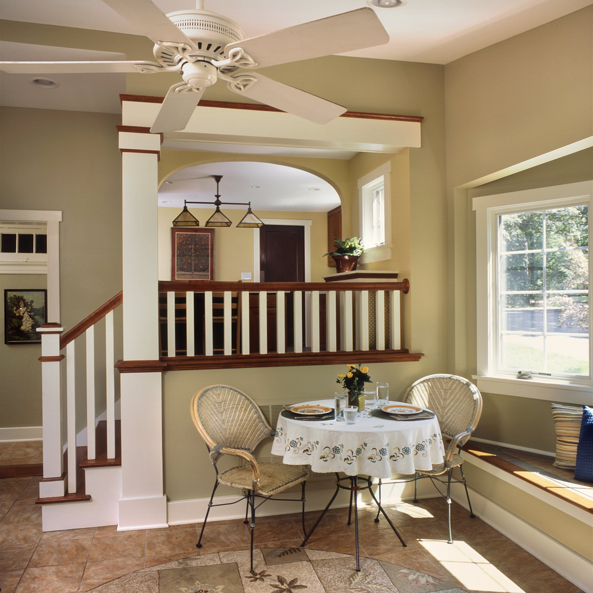 At the stairway and alcove between the Sun-room and the Kitchen, we mixed stained trim with painted trim, to make a transition from the stained cabinetry of the Kitchen to the painted walls and trim of the Sun-room.