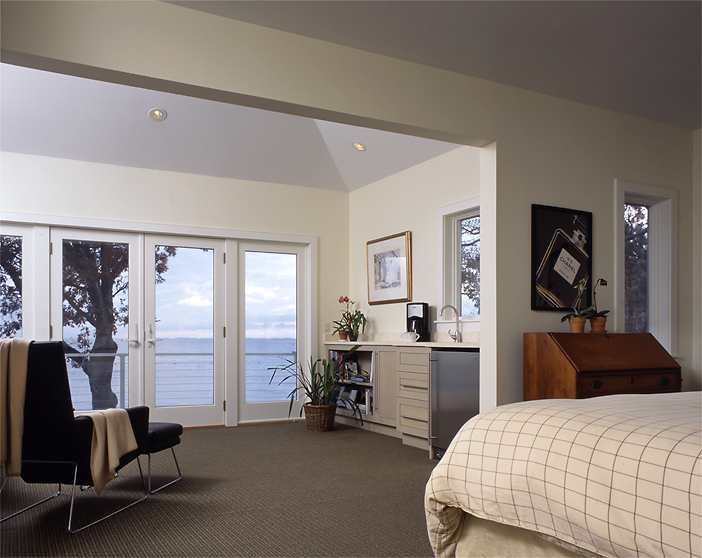 The new second floor provided a large Master Bedroom Suite, with a sitting area overlooking the ocean.