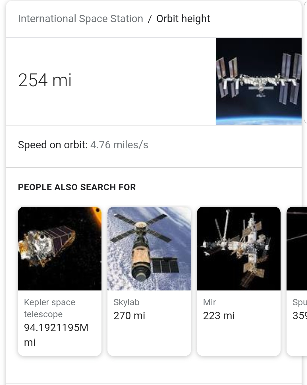 How high does the International Space Station fly above earth?