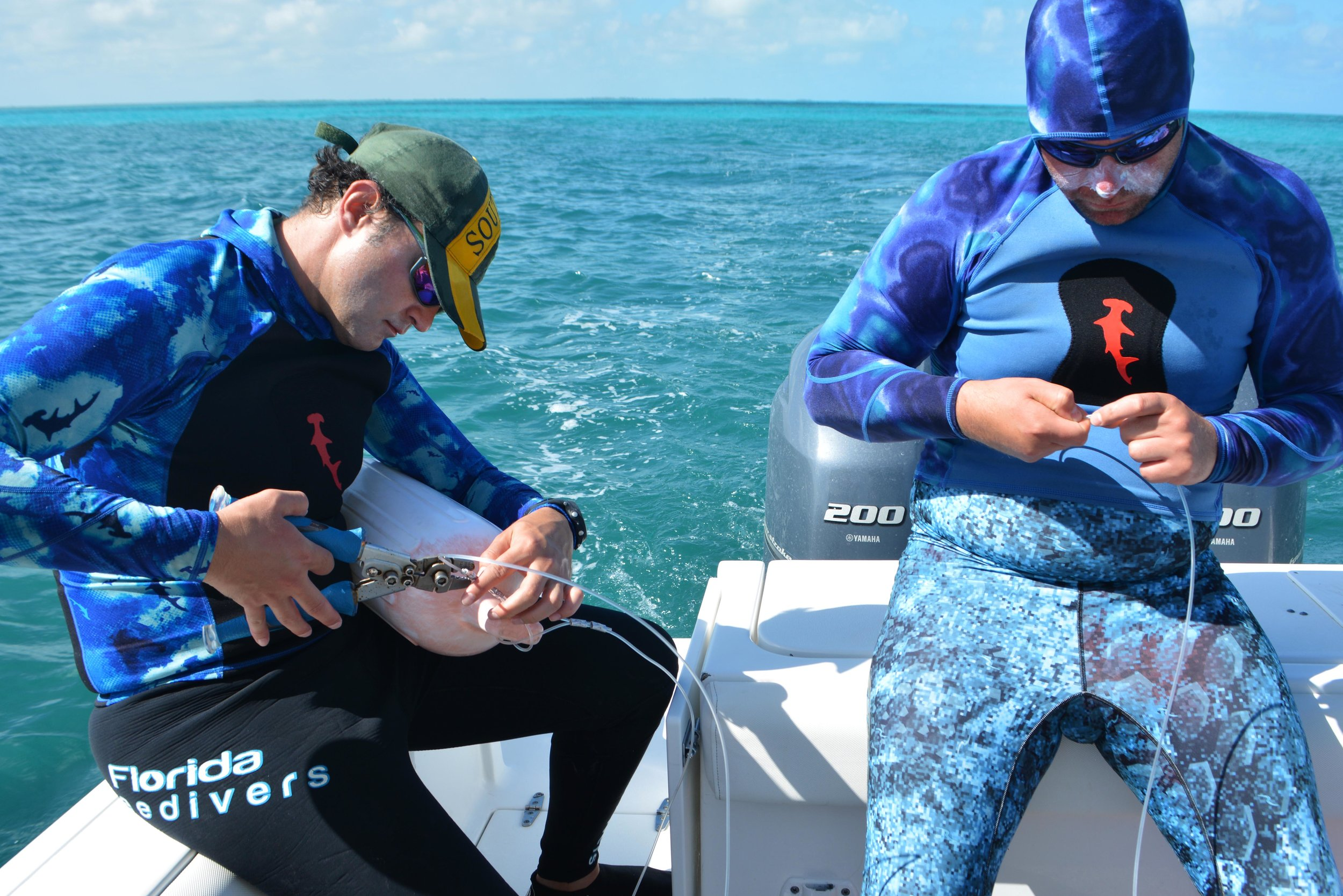 Guests Maxi and Nicky assist with building the shark block rigs