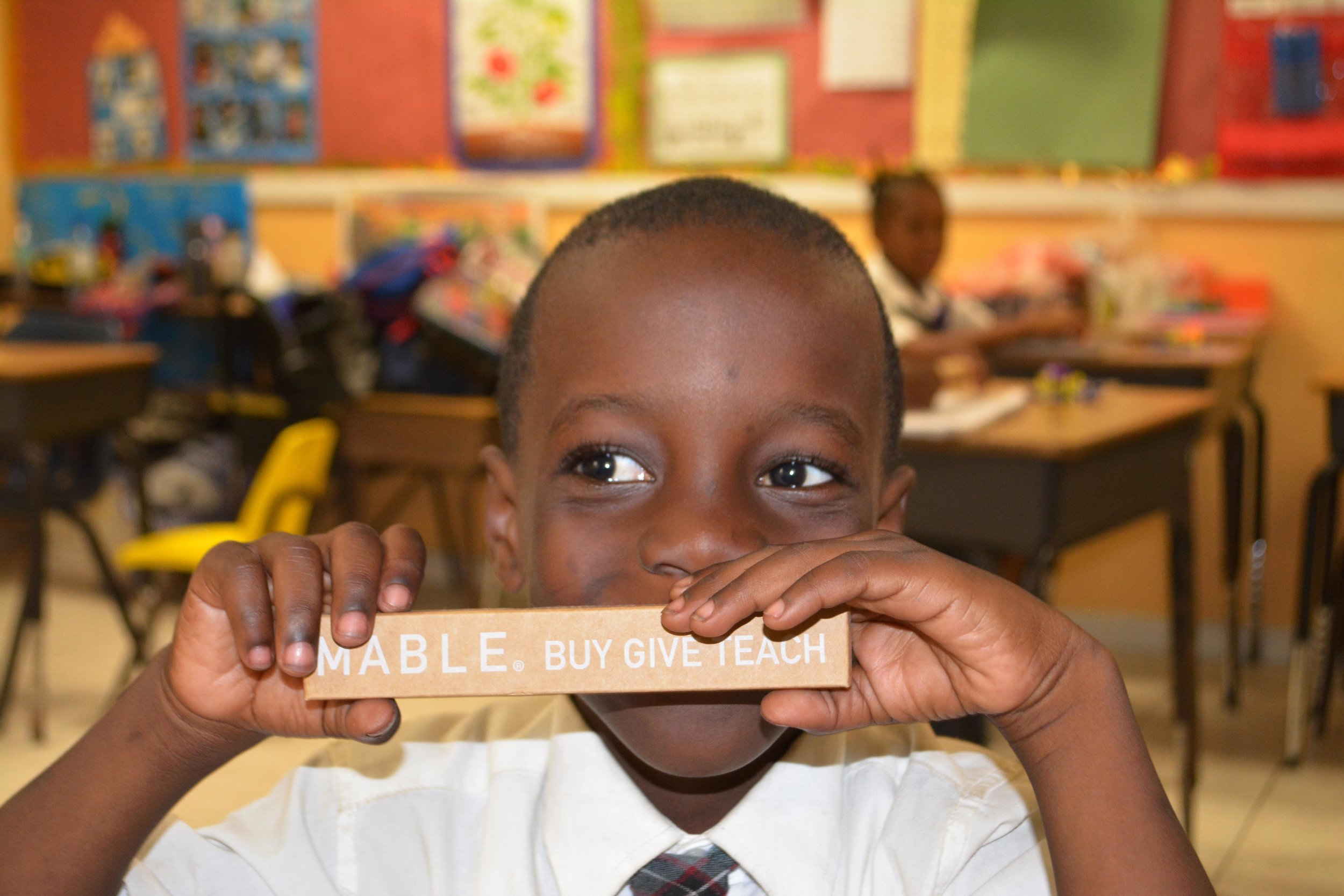 A Behring Point Primary School student holds his new, environmentally friendly gift