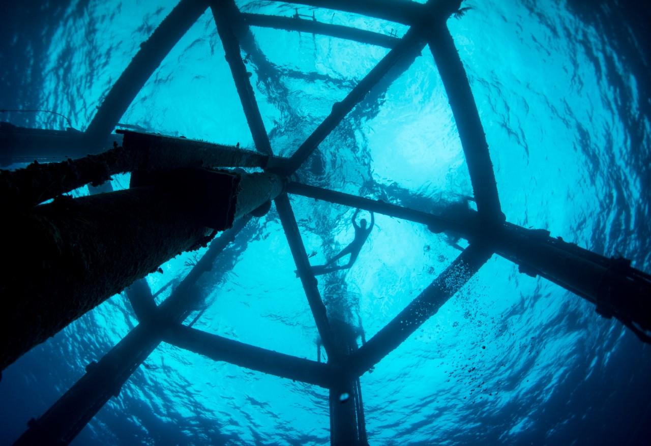 Guests enjoy a little fun exploring an ocean tower from below