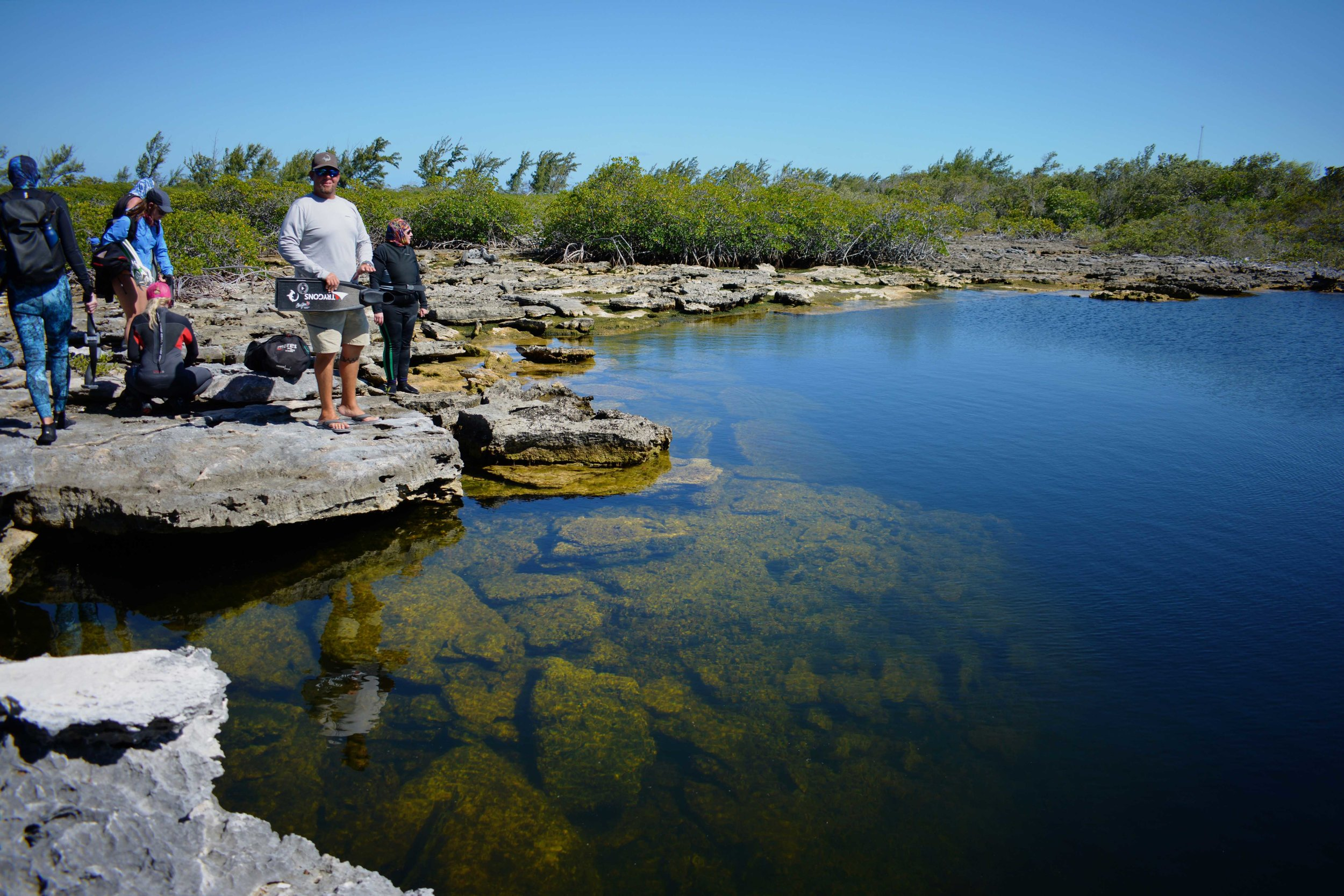 Guest visit an inland blue hole, famously explored by Jacque Cousteau