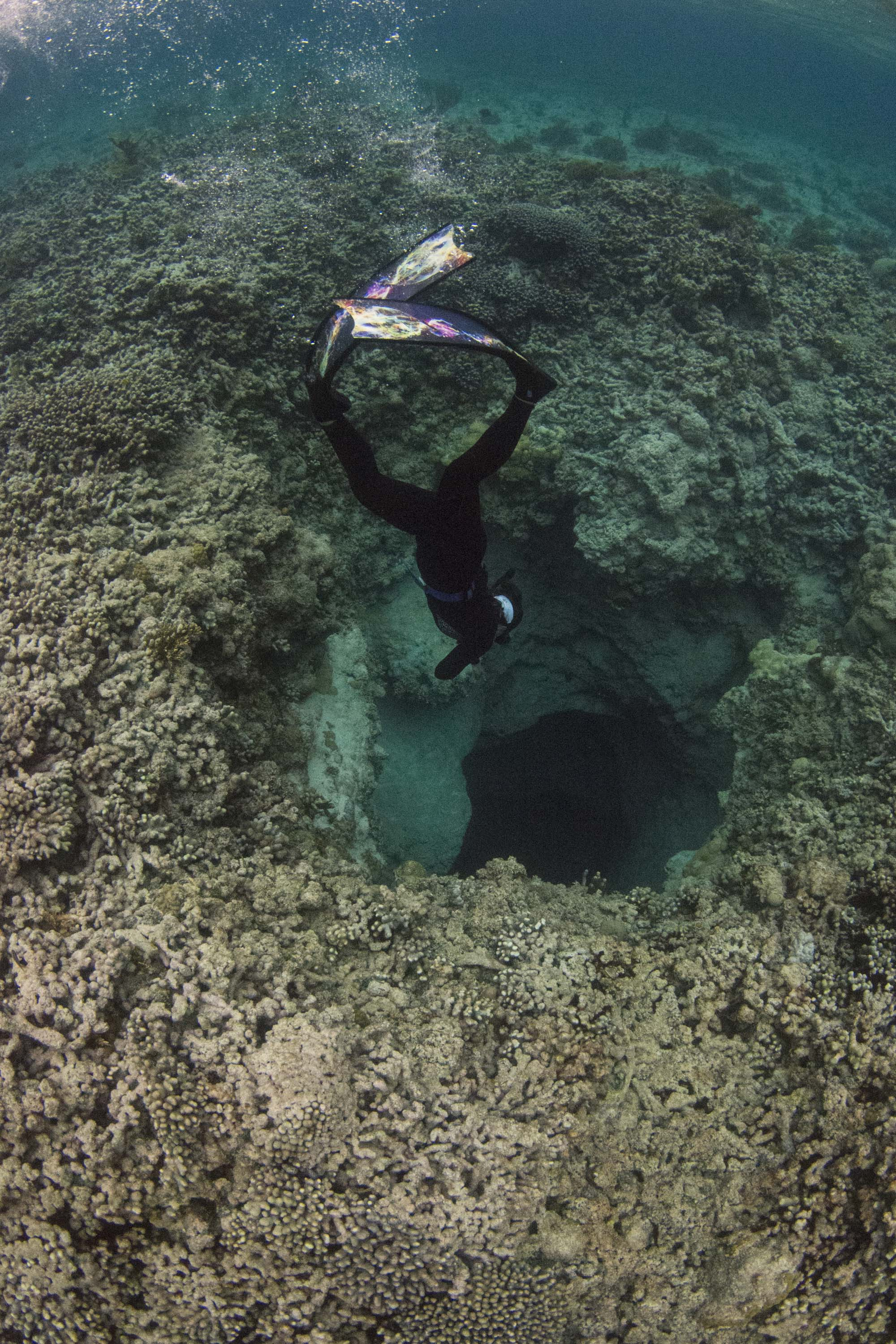 Guest Rosie dropping into a narrow blue hole