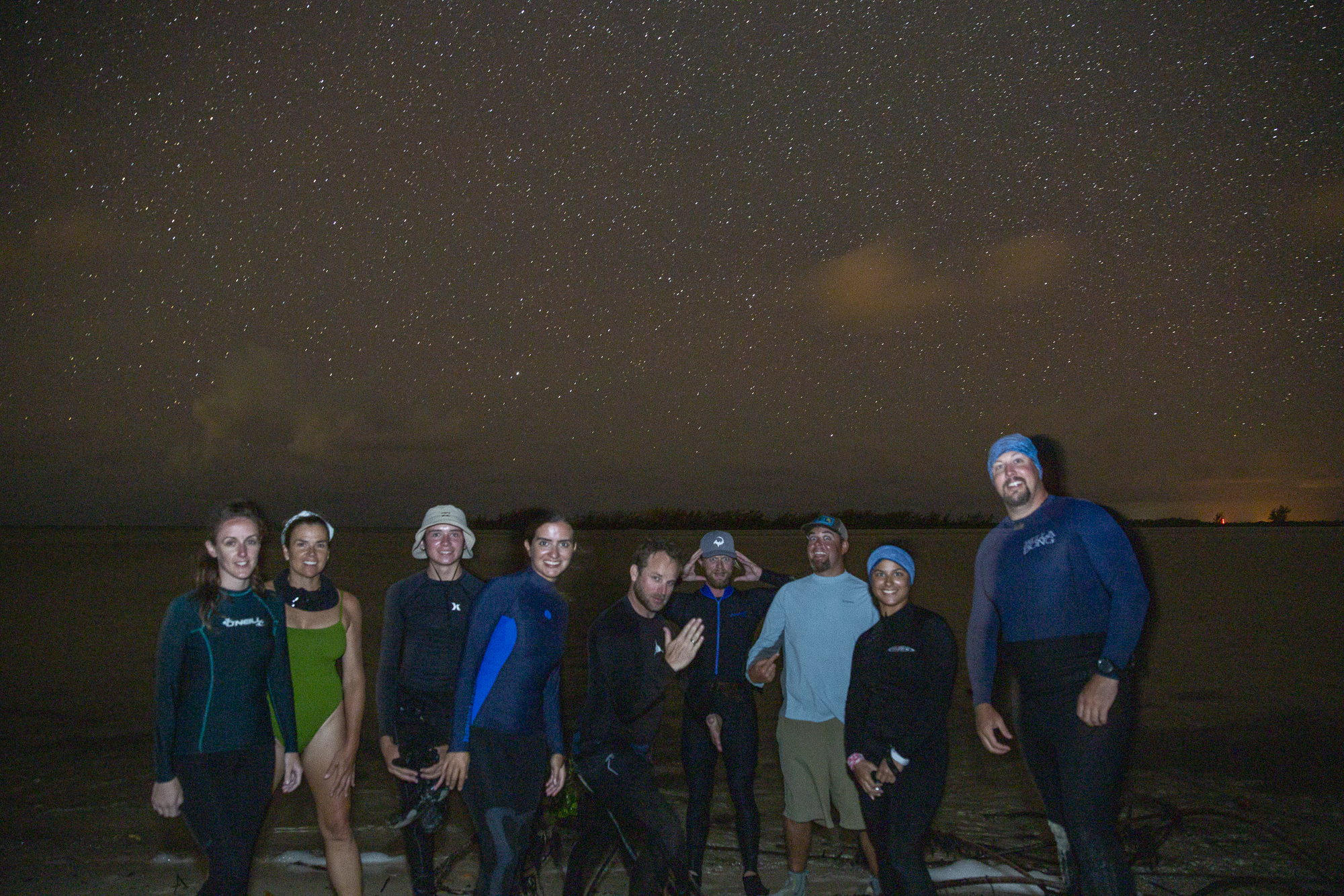 In between checks the team took a group photo under the incredible sky and enjoyed a few laughs and snacks.