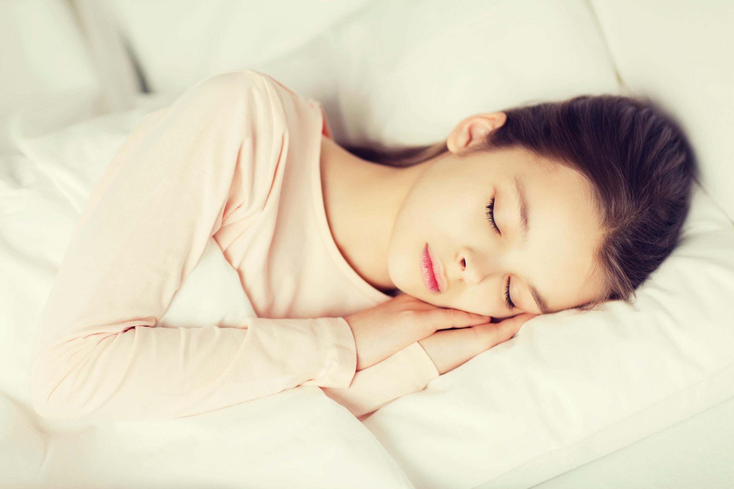girl-sleeping-in-bed-at-home-PJ939SV.jpg
