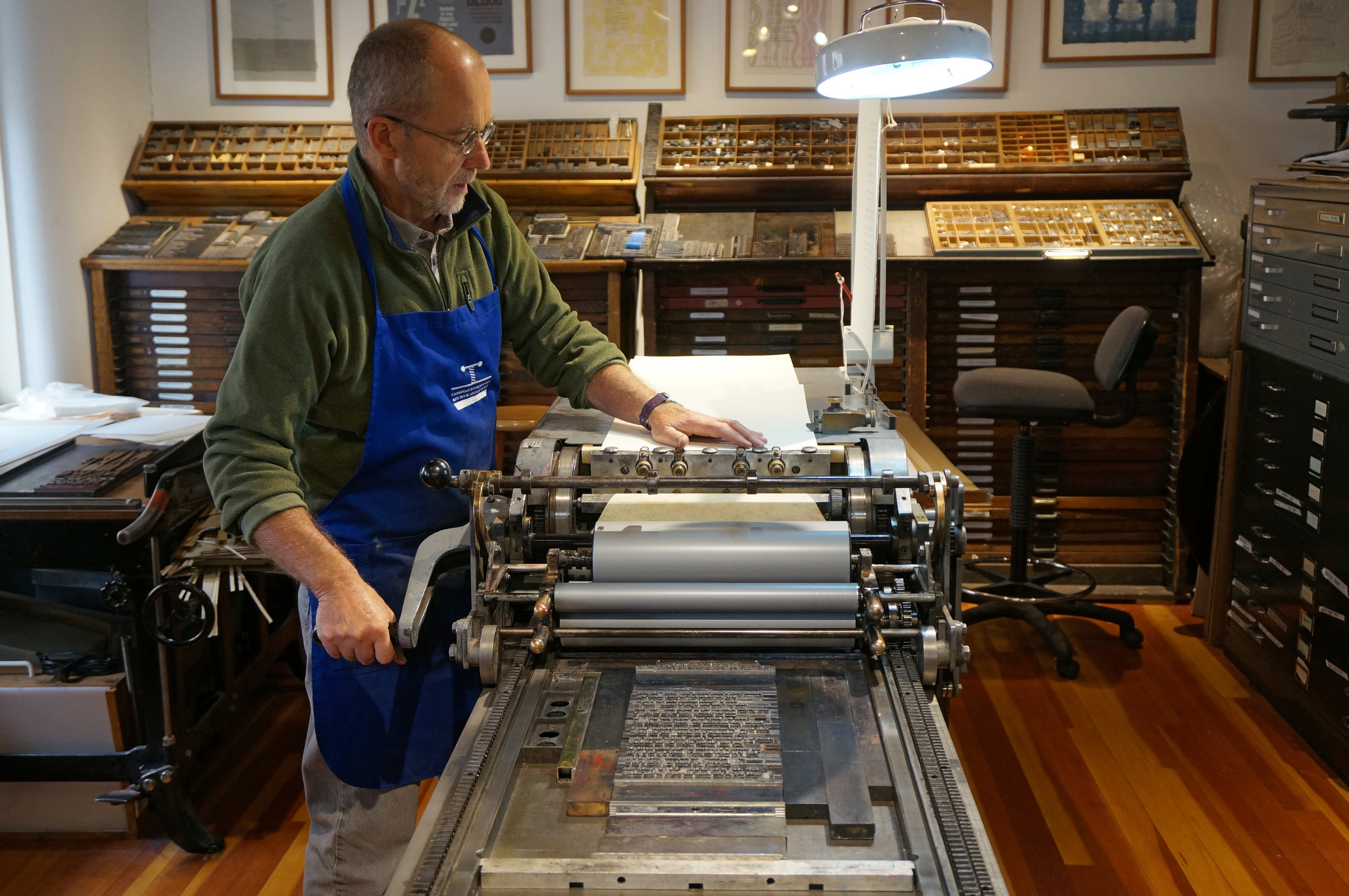 "Thomas Leech printing the broadside for Arthur Sze's piece, ""Black Center,"" at The Press at the Palace of Governors in Santa Fe, NM."