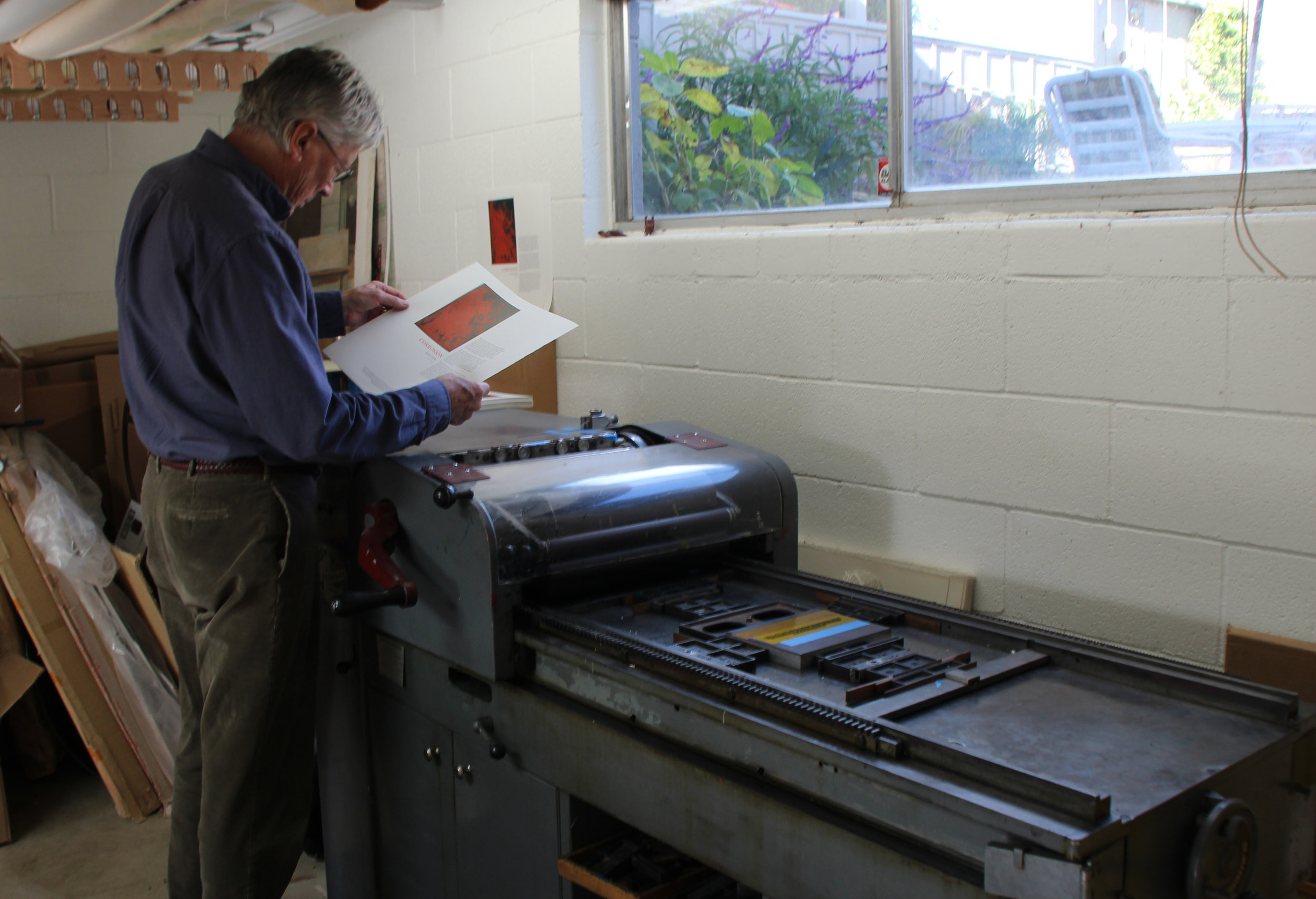 "Richard Wagener examining a copy of ""Corrosion"" in Petaluma."