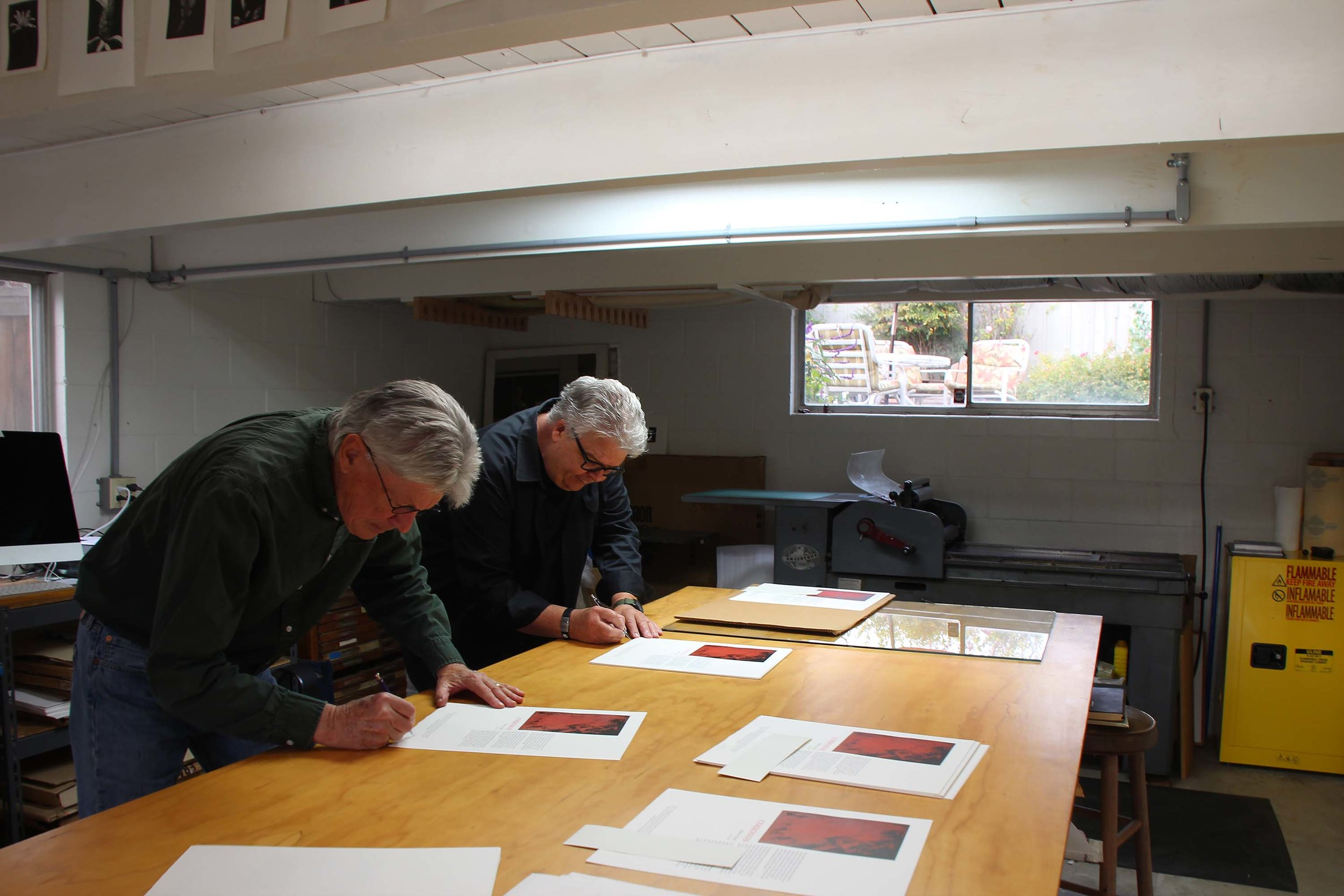 "The printer and the author: Richard Wagener and Edwin Dobb signing ""Corrosion"" at Mixolydian Editions in Petaluma."