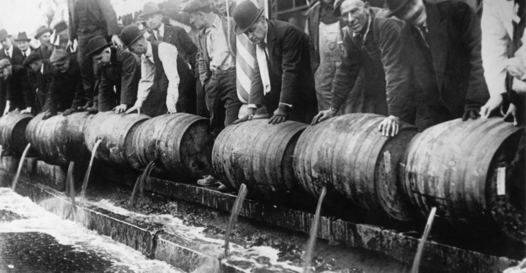Barrels of beer emptied into the sewer by authorities during prohibition in America.