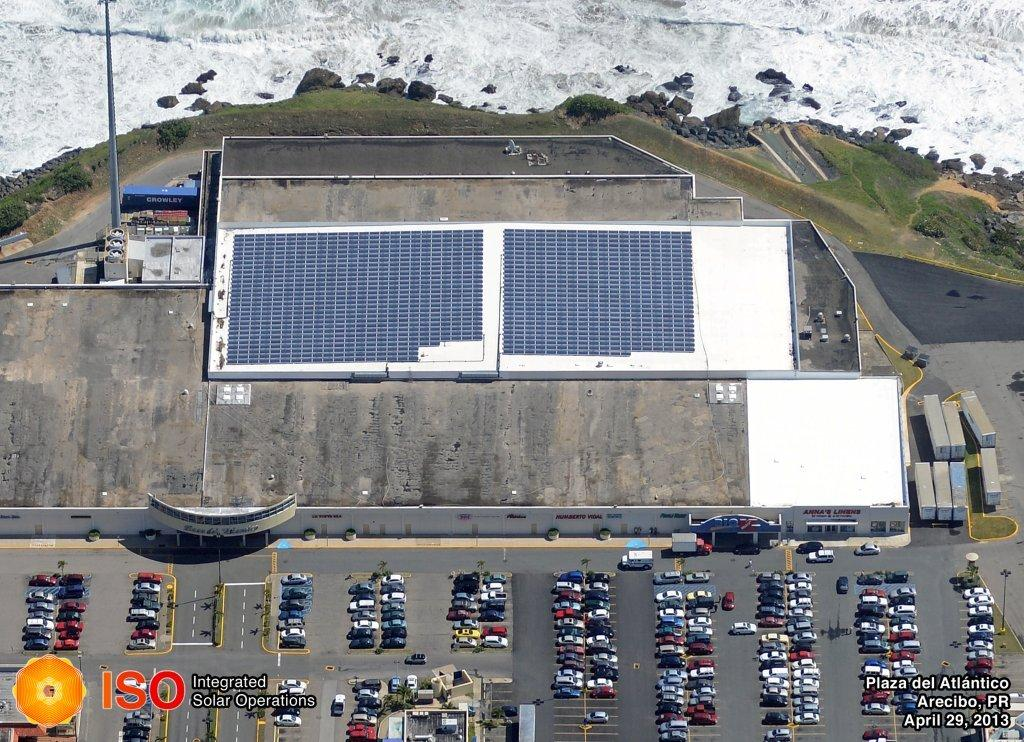 Plaza del Atlántico, Arecibo - •Fixed tilt system installation• 330 kW PV Roof top• Sun Link rack assembly•1,136 MEMC PV modules• 23 Aurora String Inverters• AC/DC installation