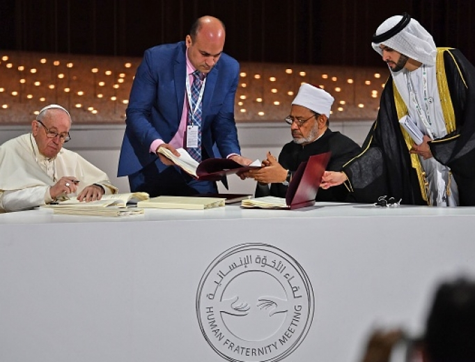 Pope Francis and Egypt's Azhar Grand Imam Sheikh Ahmed al-Tayeb (second from right) sign documents during the Human Fraternity Meeting at the Founders Memorial in Abu Dhabi Feb. 4. (VINCENZO PINTO/AFP/Getty Images)