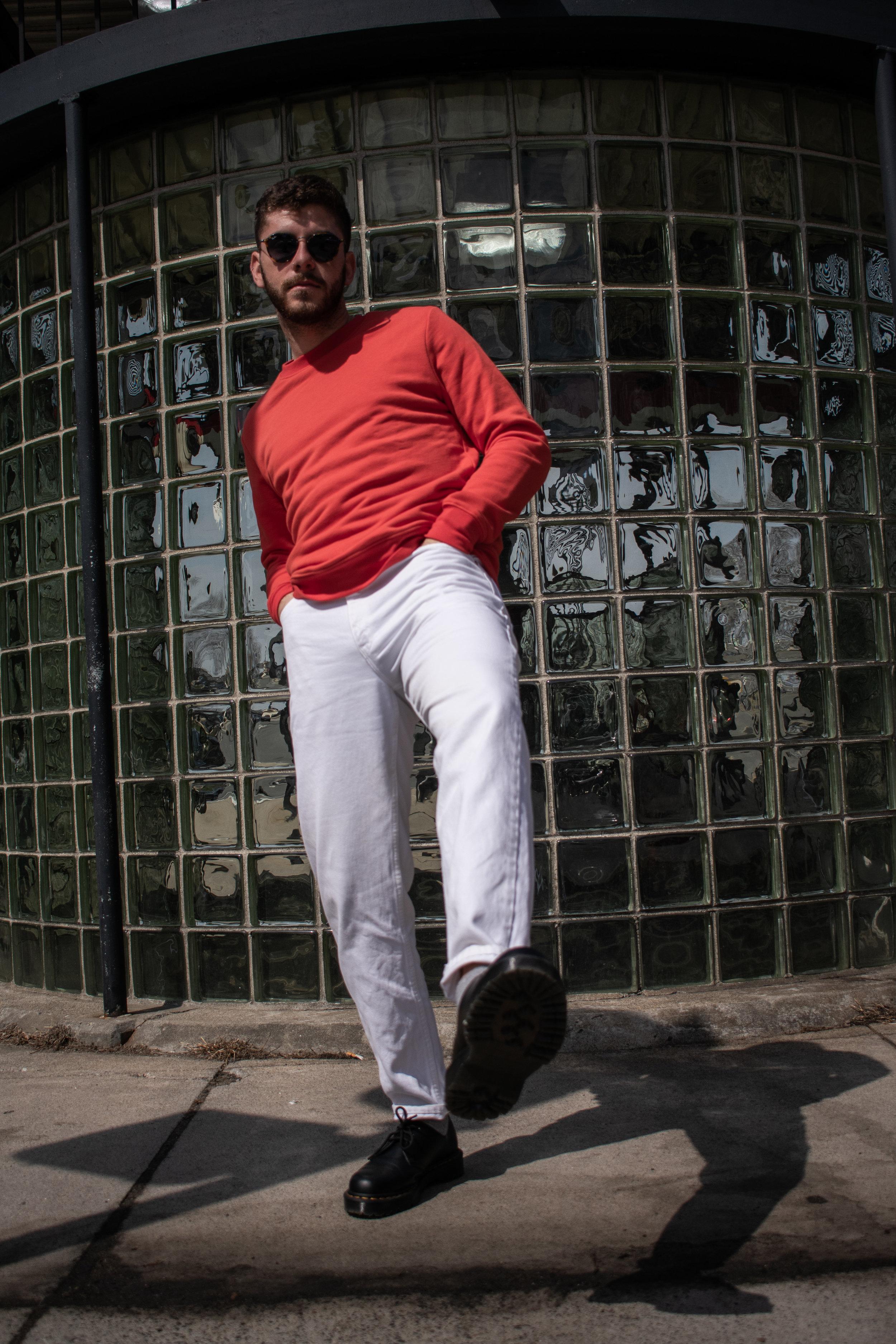 white denim. orange sweatshirt.