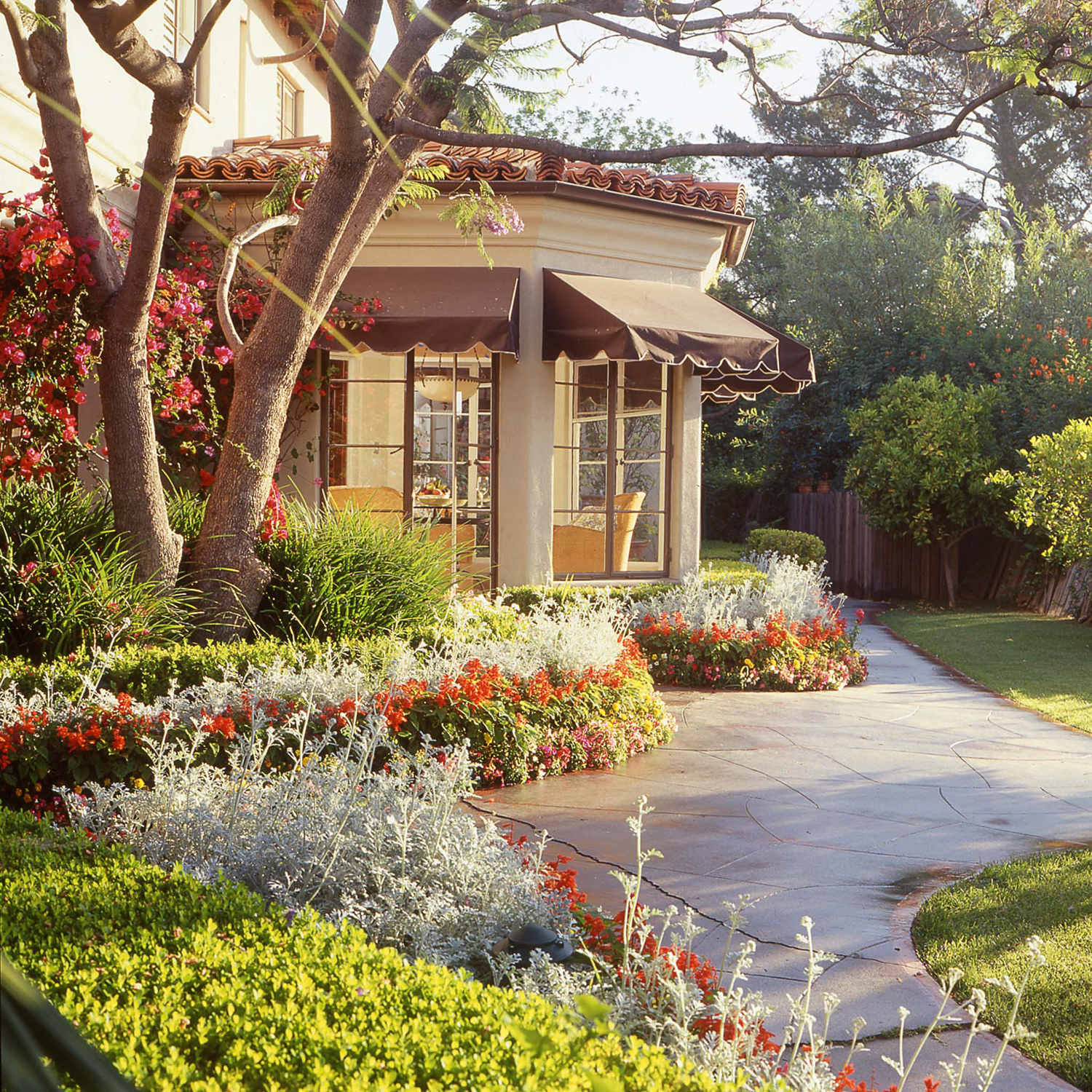 Daylight Exterior, with interior lighting, of the landscaping of a home in Beverly Hills. Photo was for Holden Water Landscaping's portfolio.