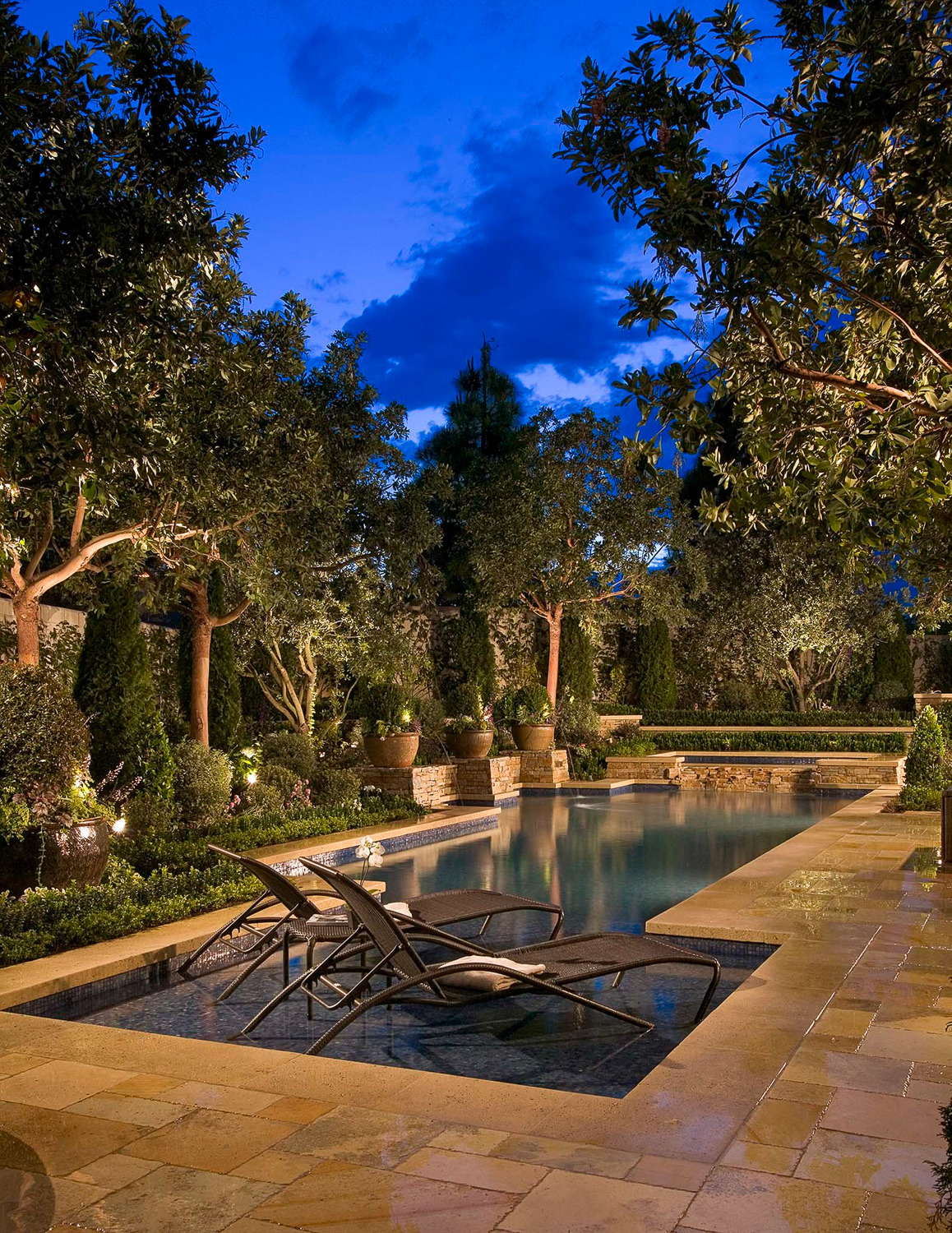 Dusk exterior of a private residence in Newport Coast. Photographed for Southwest Pool and Landscaping. All of the lighting in this photo was added by me to create the look.
