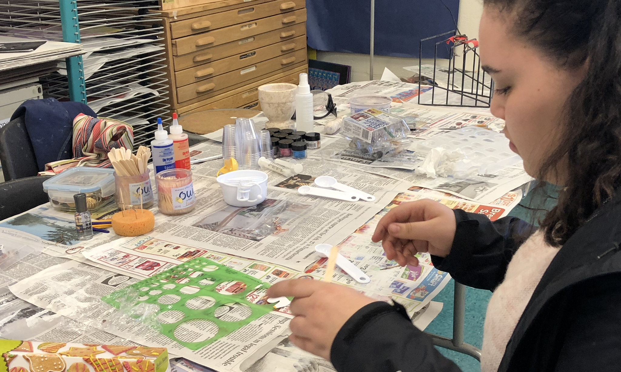Students experiment with applications of resin, record observations, and make revisions -