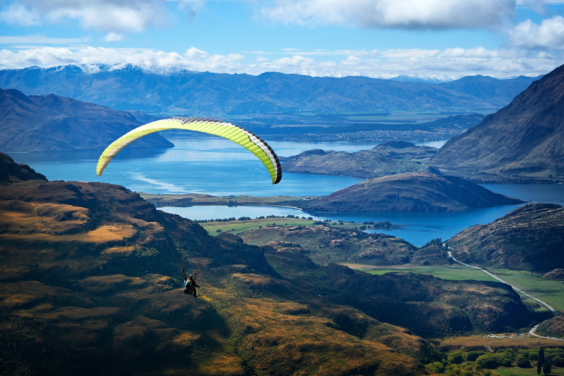 Our Mountain - We fly from Pub Corner, on the road going up to Treble Cone ski field. Our launch is 800m above the valley and is the highest summertime tandem flight in New Zealand.You will experience beautiful views of Lake Wanaka, Roys Peak, and the Matukituki Valley leading into Mt. Aspiring National Park.This flying site is one of the most spectacular in New Zealand and is the home to the NZ Paragliding Nationals.