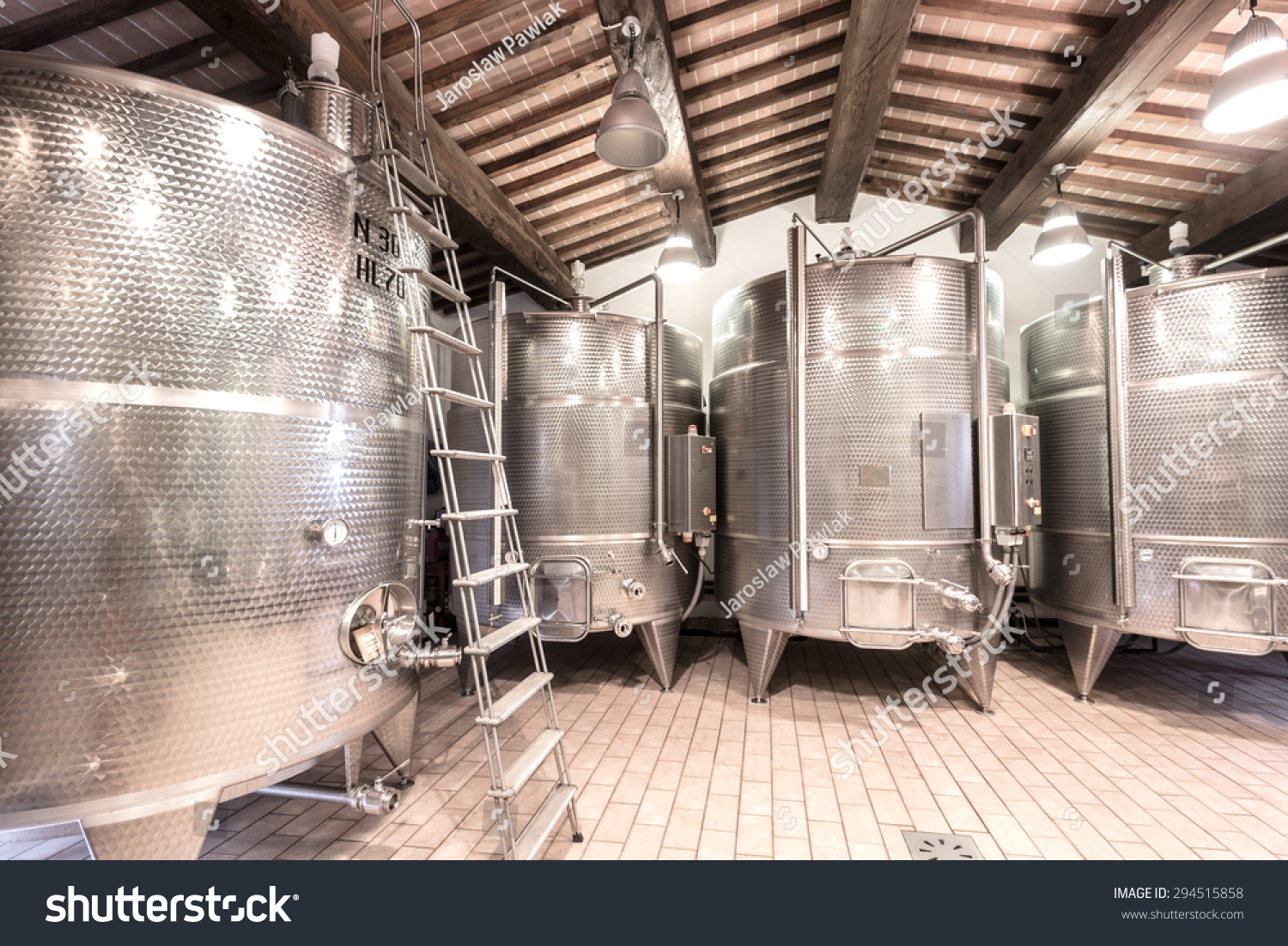 stock-photo-aluminum-containers-for-maturing-wine-in-a-winery-294515858.jpg