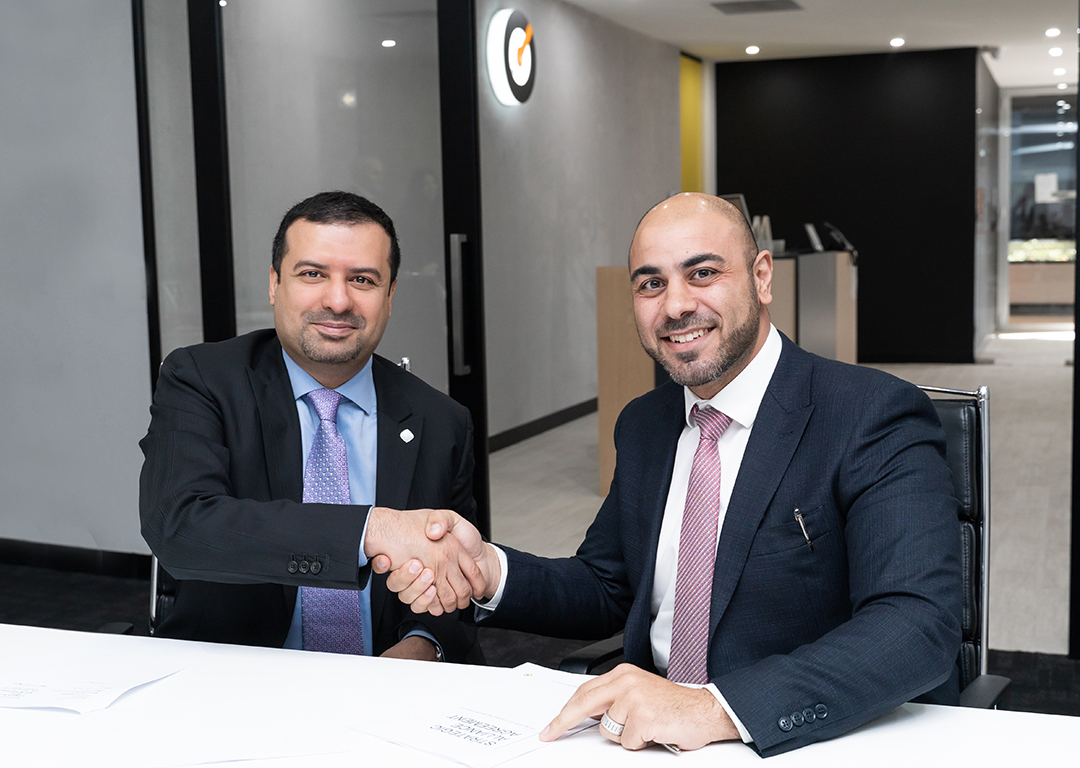From L-R: CEO of the Dubai Blockchain Centre Dr Marwan Alzarouni and CEO of Till Payments Shadi Haddad signing the partnership agreement