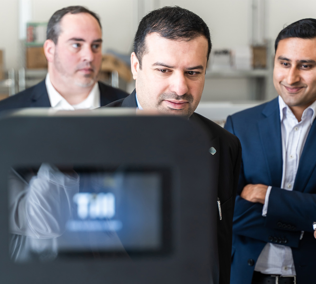 From L-R: Till Payments Development Manager Richard Lane, CEO of the Dubai Blockchain Centre Dr Marwan Alzarouni and Austrade Senior Adviser, Services & Technology Gaurav Johri inspect a Till product