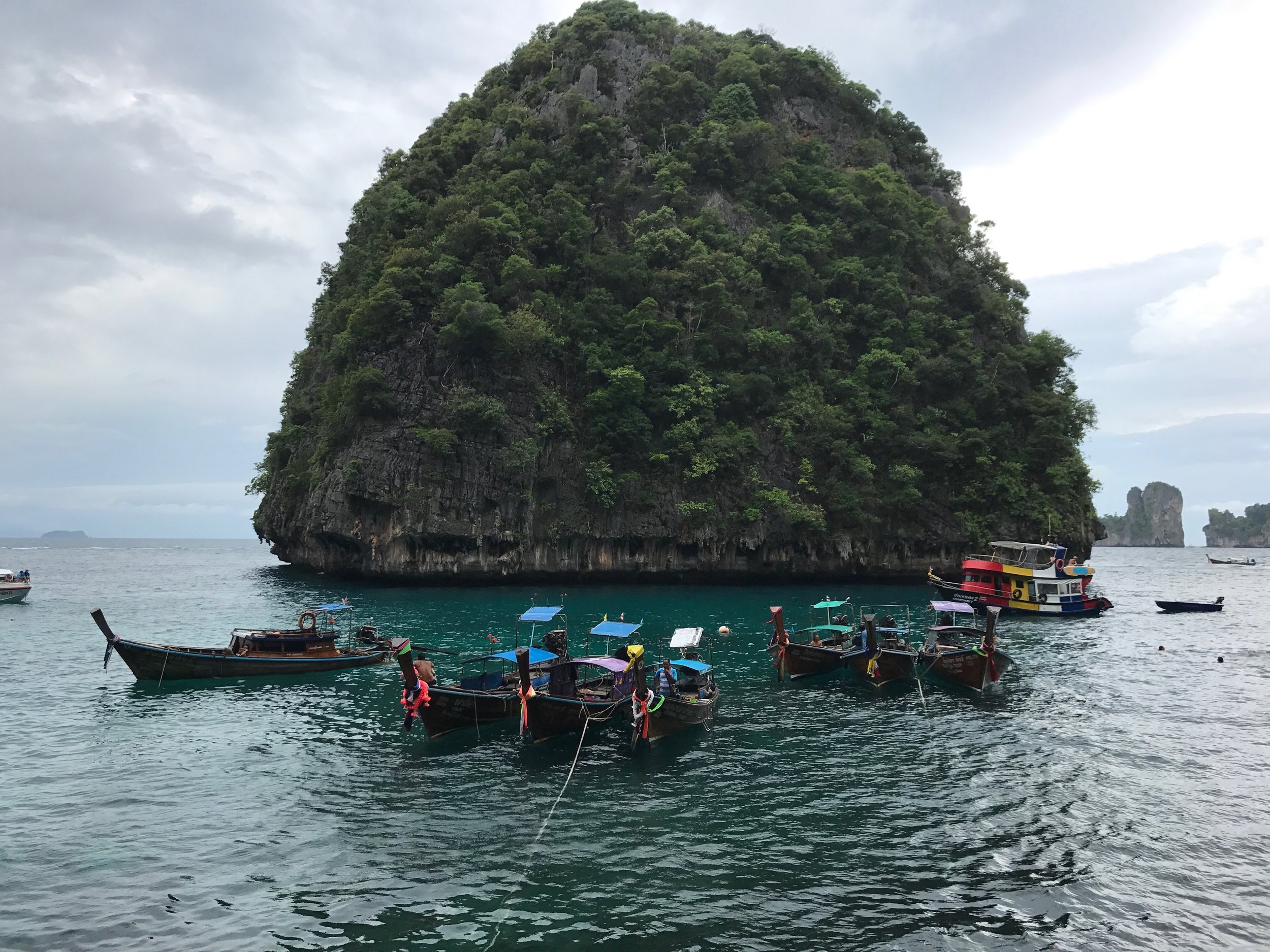 The Phi Phi Islands... - The Phi Phi Islands are located in Thailand, between the large island of Phuket and the western Andaman Sea coast of the mainland.