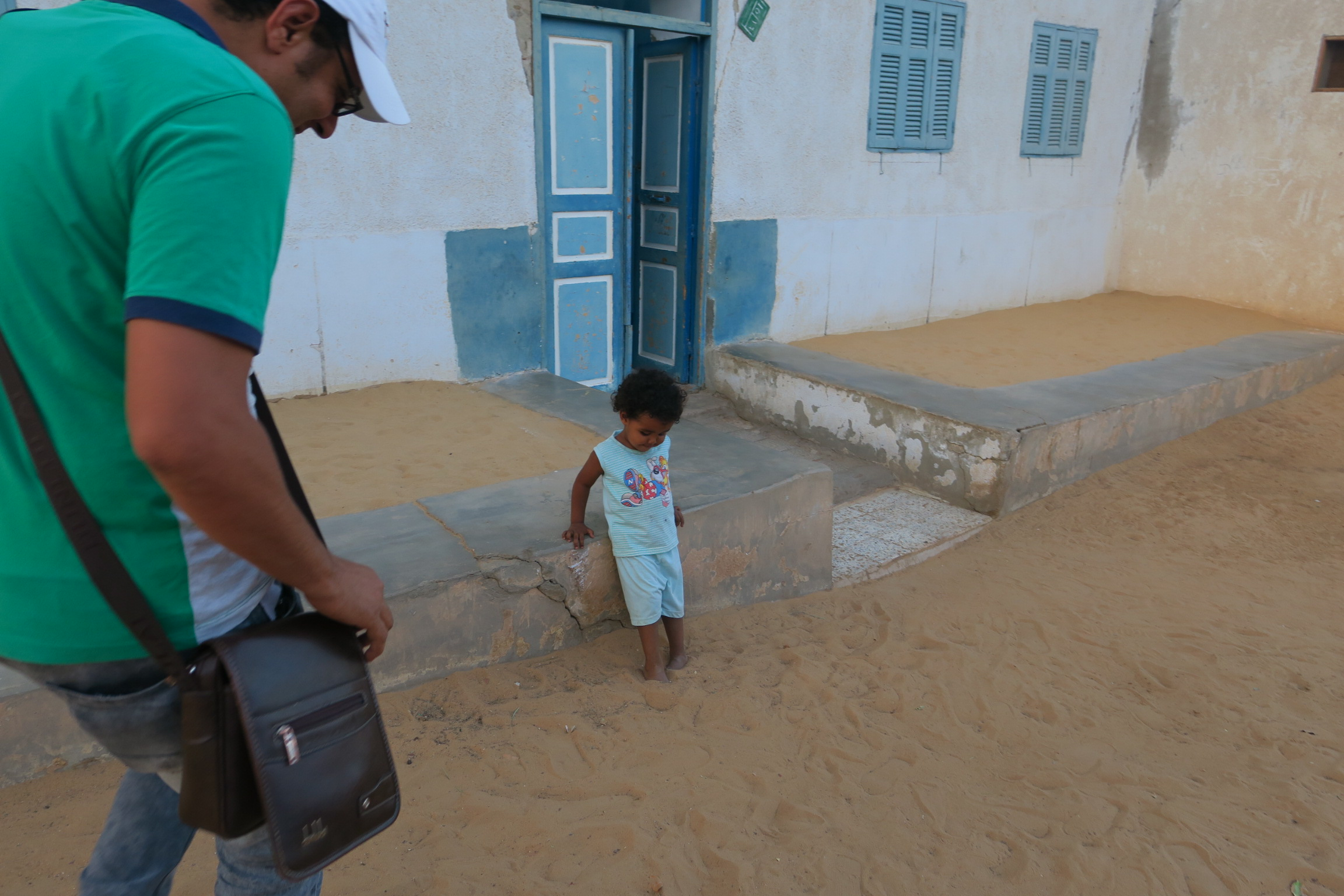 Mahmoud Ali- Tour Guide for Aswan interacting with one of the Beautiful children in the Nubian Village
